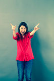 Fun 30s woman shouting with extrovert hand gesture Royalty Free Stock Photos
