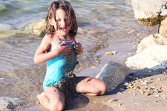 Fun in the sand. A young child having fun in the sand Stock Images