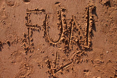 Fun in the Sand. The word Fun finger drawn in beach sand Stock Photos