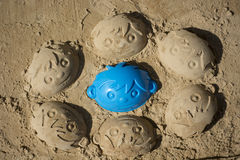 Fun sand faces of boys Stock Photos
