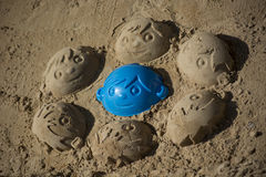 Fun sand faces of boys Royalty Free Stock Image