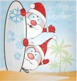 Fun santa claus cartoon with surfboard Royalty Free Stock Photos