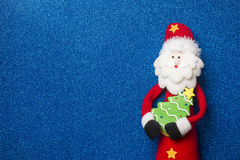 Fun Santa Claus Christmas card. Copyspace. Funny Santa Claus Christmas card, Santa and cute tree on blue glitter background with copyspace Royalty Free Stock Photography