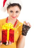 Fun santa woman with gift Stock Photo
