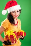 Fun santa woman with gift Stock Images