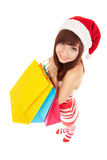 Fun santa woman with packages royalty free stock photography