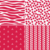 Fun seamless red and white patterns. Set of cute seamless background patterns in red and white for gift wrapping paper, textiles, scrapbooking. Includes polka Royalty Free Stock Photography