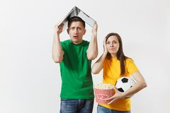 Fun shocked couple, woman man, football fans in yellow green t-shirt cheer up support team with soccer ball, with pc stock images