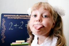 Fun in shool. Fun. An image of Little girl sitting near chalkboard Stock Photography