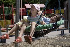 Fun of sister on the seesaw Stock Images