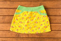 Fun skirt on a wooden background . Children`s clothes. The view royalty free stock photography
