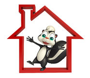 Fun Skunk cartoon character with home sign Royalty Free Stock Photo
