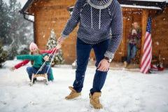 Fun sledding- Family enjoying on winter Stock Photo
