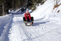 Fun on a sledge track Royalty Free Stock Photos