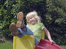 Fun on a slide. Young girl having fun with a slide Royalty Free Stock Image