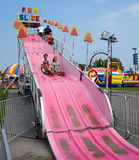 Fun Slide Ride. A family has a fun slide ride at the Champlain Valley Fair, Essex Junction, Vermont royalty free stock photo