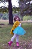 Fun smile humor tree glee children merriment cheer fashion beauty people spring happy autumn childhood outdoors cute kid green par. Happy girl outdoors in green Royalty Free Stock Photos