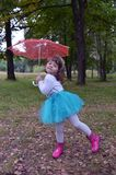 Fun smile humor tree glee children merriment cheer fashion beauty people spring happy autumn childhood outdoors cute kid green par. Happy girl outdoors in green Royalty Free Stock Photography