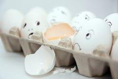 Fun smile white row eggs. Eggs with smile on the white background Royalty Free Stock Image