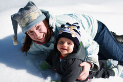 Fun on the snow. Mother and her son having fun on the snow during sunny day Stock Images