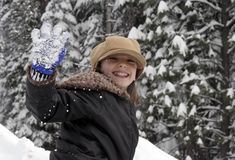 Fun in the Snow. Little girl waving in the snow Royalty Free Stock Images