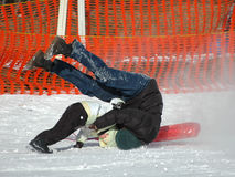 Fun in the snow. Father and son falling off the sledge Stock Photos