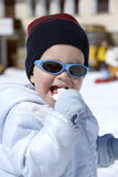 Fun in the snow. A little baby boy dressed in winter clothes Stock Photography
