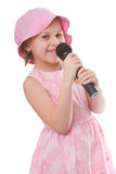 Fun song. Girl sings a song in a microphone isolated on a white background Royalty Free Stock Photos