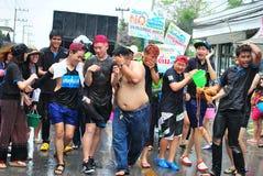 Fun In Songkran Festival. Young Girl Splashing Water Fun Songkran Festival.Lamphun, Thailand Royalty Free Stock Photo