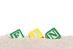 Fun Spelled Out on Sand Royalty Free Stock Image