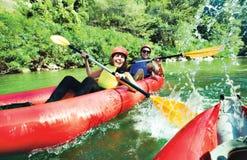Fun splashing canoe river Royalty Free Stock Images