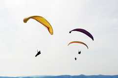 Fun sports: Paragliding. Extreme sports: Three colorful paraglider in the air Royalty Free Stock Photo