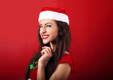 Fun squint excited grimacing woman in santa claus christmas cost Stock Image