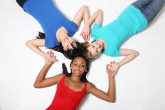 Fun star shape by three teenage girl friends Royalty Free Stock Photography