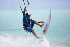 Fun with strapless board. A kitesurfer performing an aerial trick riding strapless surfboard on a sunny day Royalty Free Stock Image