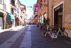 Fun Street. Ancient street with many shops, decorated with umbrellas of multiples colors, Ferrara, Italy Royalty Free Stock Photos
