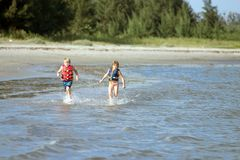 Fun in the Sun. Two children playing on the Beach Stock Photography