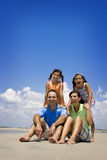 Fun in the sun. Family on vacation walking on a beach Stock Images