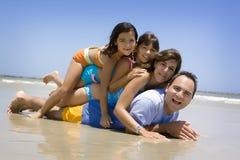 Fun in the sun. Family having fun on a beach Stock Image