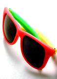 Fun in the Sun. Tri colored sunglasses Royalty Free Stock Image