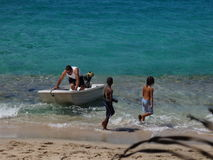 Fun in the sun at lower bay bequia. Royalty Free Stock Photo
