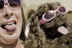 Panting Tongues and Fun at the Ugly Dog Show. A woman and her pooch pose to win at the ugly dog show Stock Images