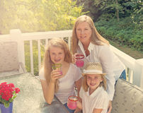 Fun in the sun wth family on outdoor patio during bright day Royalty Free Stock Photos