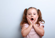 Fun surprising kid girl with opened mouth looking Stock Photos