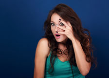 Fun surprising makeup woman covering face the manicured fingers Royalty Free Stock Photography