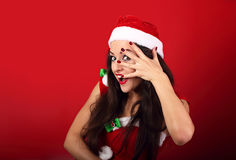 Fun surprising makeup woman covering face the manicured hand wit Royalty Free Stock Image