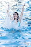 Fun at Swimming Pool. Teenager having fun at swimming pool royalty free stock photography