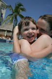 Fun in swimming pool. A mother and son having great time together in an outdoor swimming pool Stock Photo
