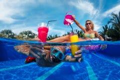 Fun in swimming pool Royalty Free Stock Photos