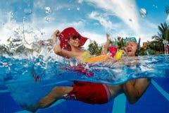 Fun in swimming pool Stock Images